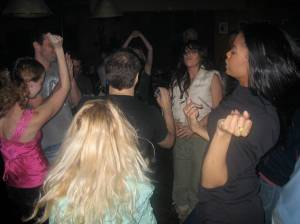 The cast dancing away