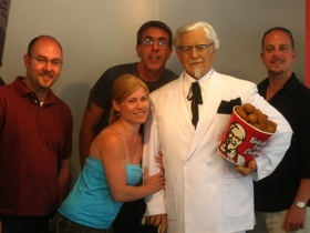 Jovon, Ken, Karl and I with Colonel Sanders - they revere the Colonel here
