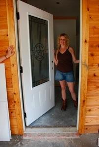 Suzanne at her front door