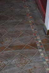 The new tile (before cleaning off the grout)