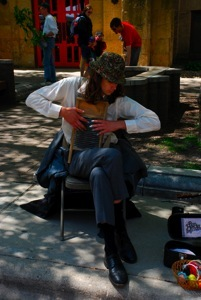 A musician playing a washboard