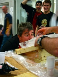 Gary taking a shot from the ice luge