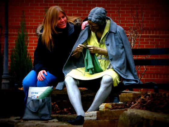 Outside the theater there is randomly this statue of a knitter!
