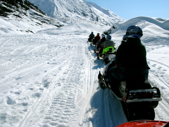 Heading up the mountain on our snowmobiles