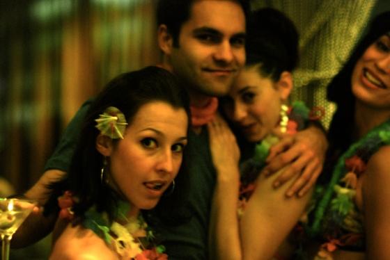 Sarah, David, Alexa and Carissa in Hawaiian wear at the bar