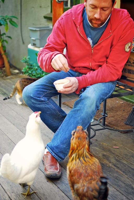 Chris feeding his chickens